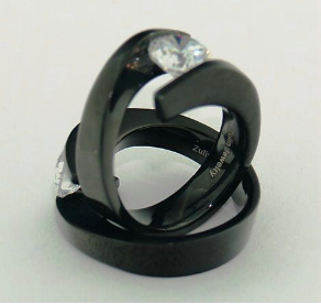 Unique Spiraling Black Titanium Ring with Tension Set CZ