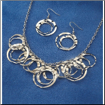 Stainless Steel Circle & Wave Necklace and Earring Set
